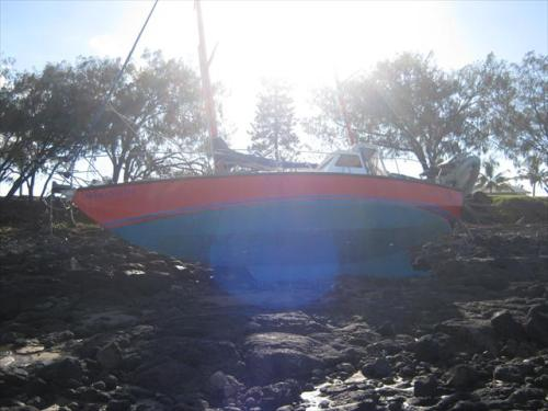 image of port side of yacht Maranatha high and dry on Oaks Beach